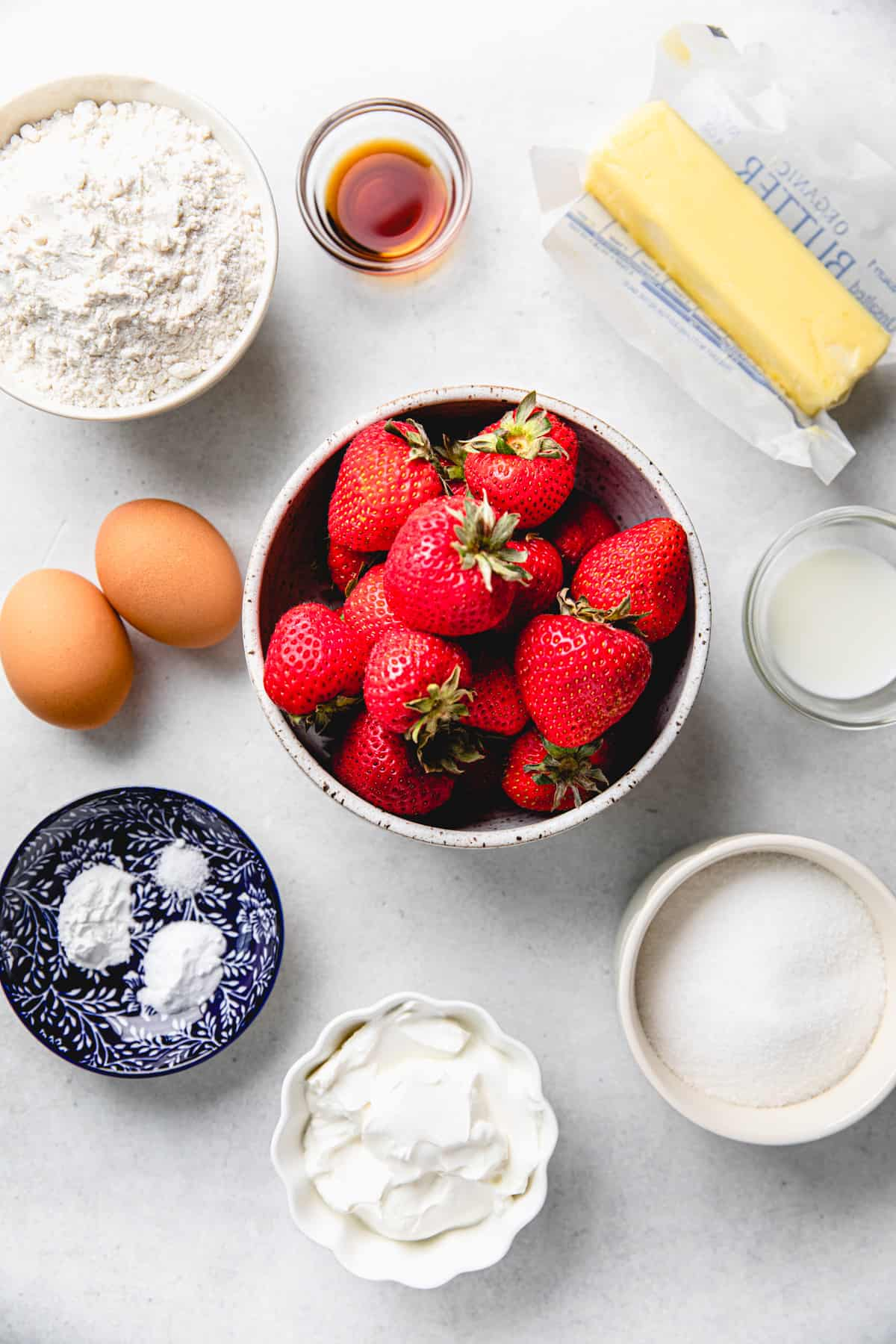 Ingredients for Vanilla Strawberry Cake in separate bowls.