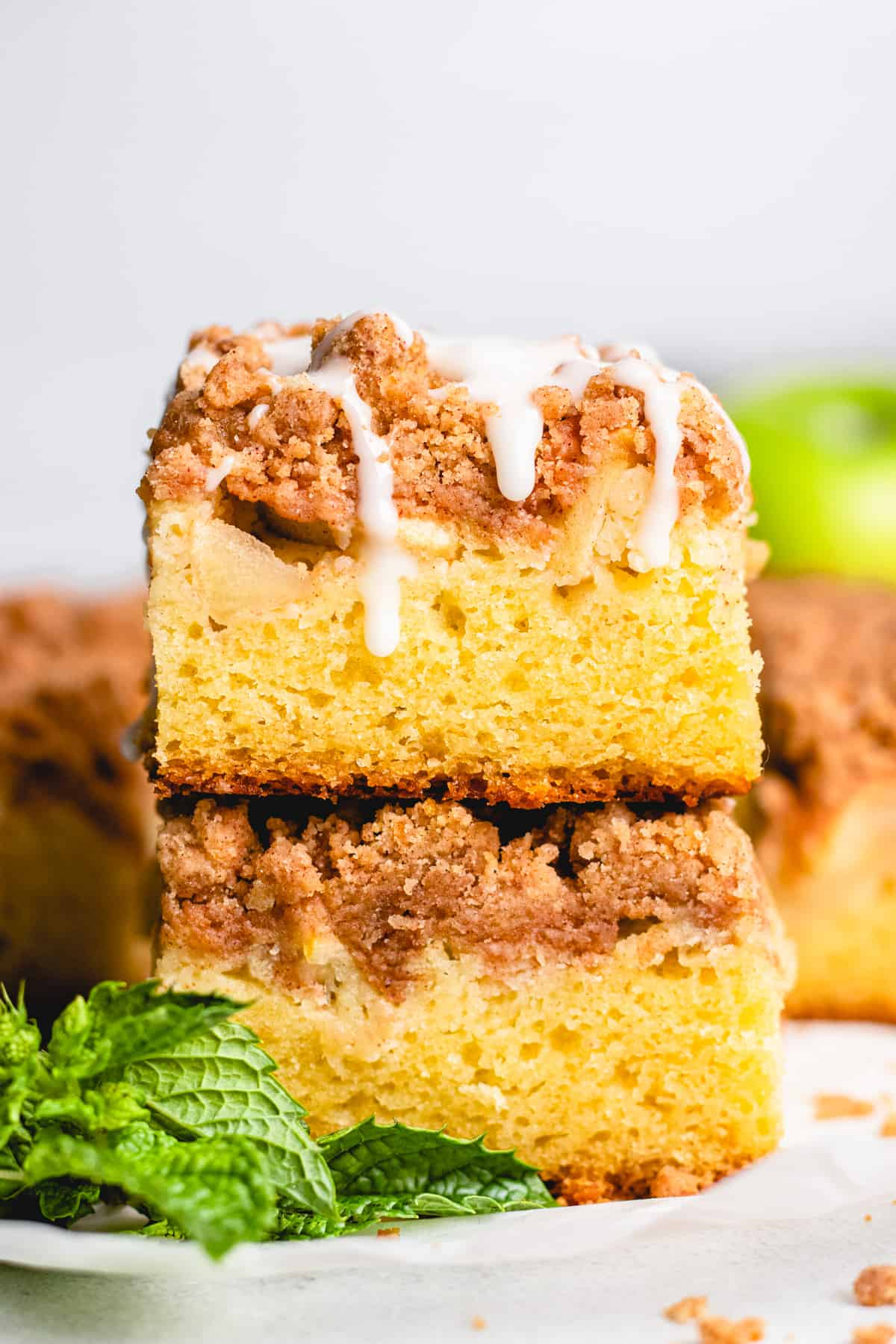 Two slices of apple crumb cake on top of each other.