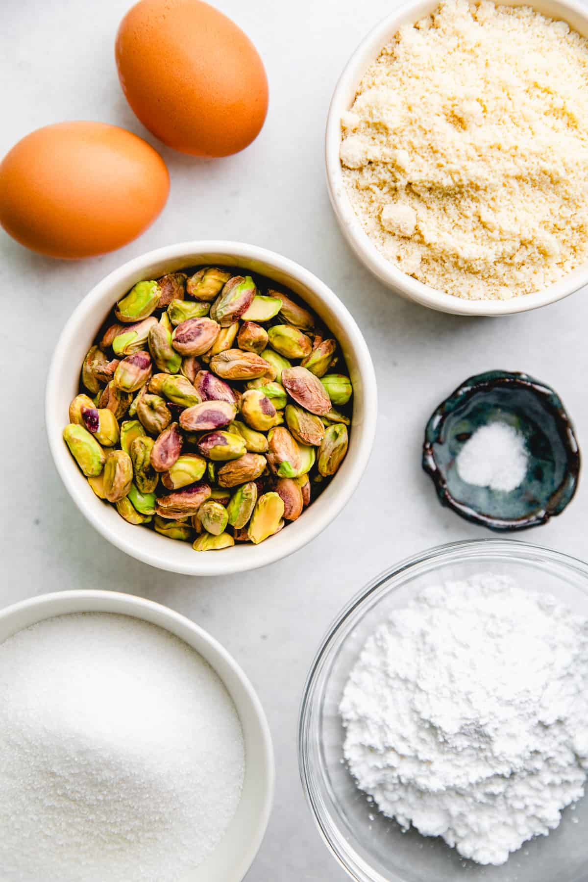 Ingredients for Pistachio Cookies in separate bowls.