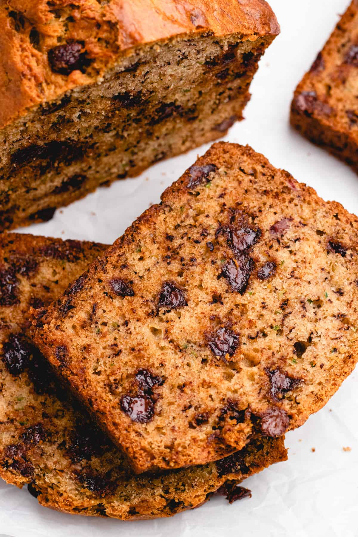 Sliced zucchini banana bread with chocolate chips.