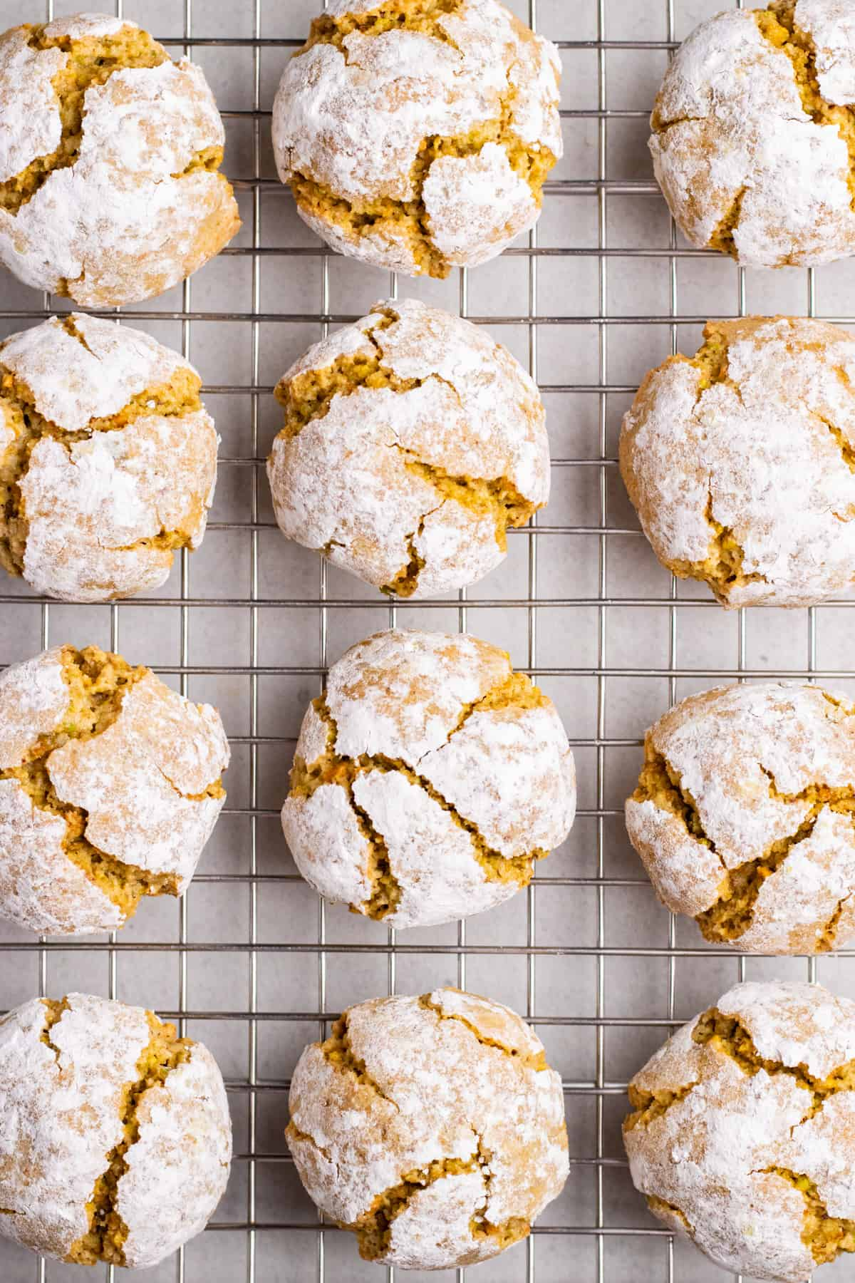 Crinkle pistachio cookies on a wire rack.