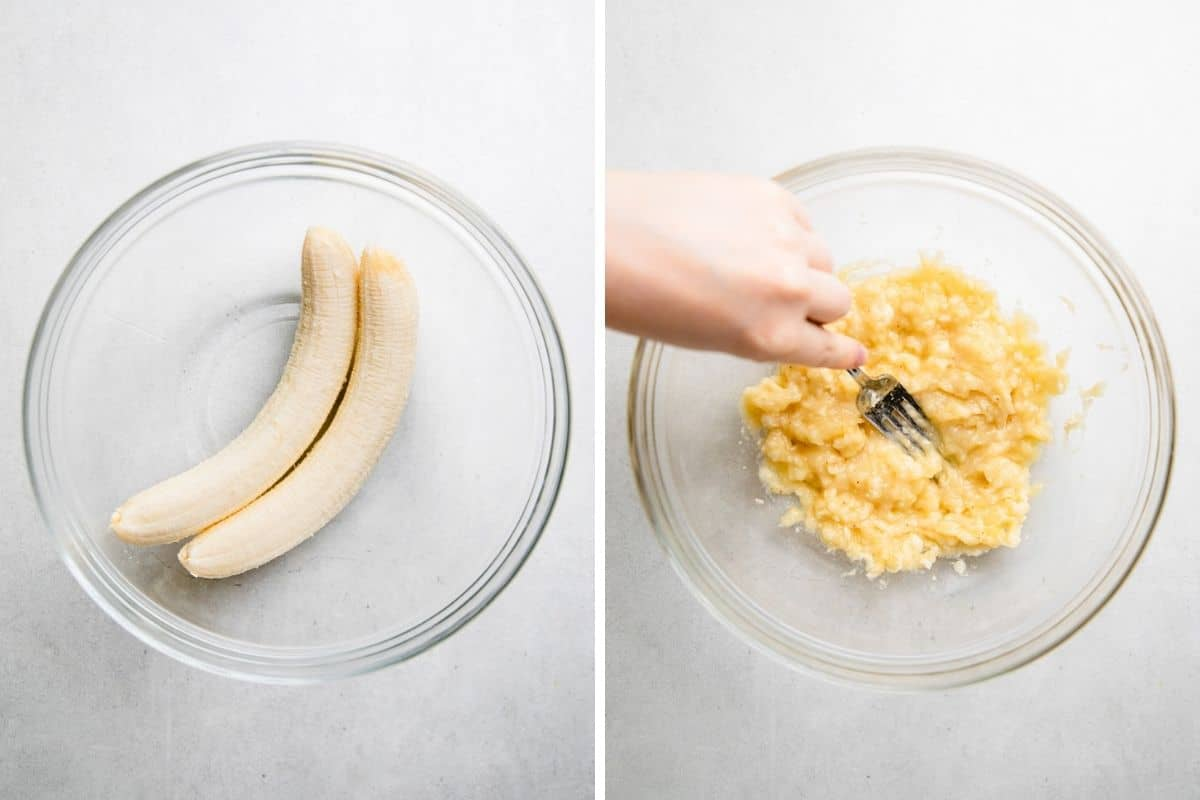 Mashing two bananas into a glass bowl with a fork.