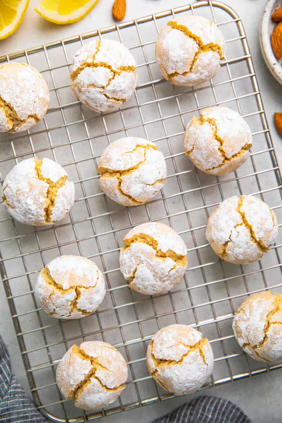Crinkled amaretti cookies on a wire rack.