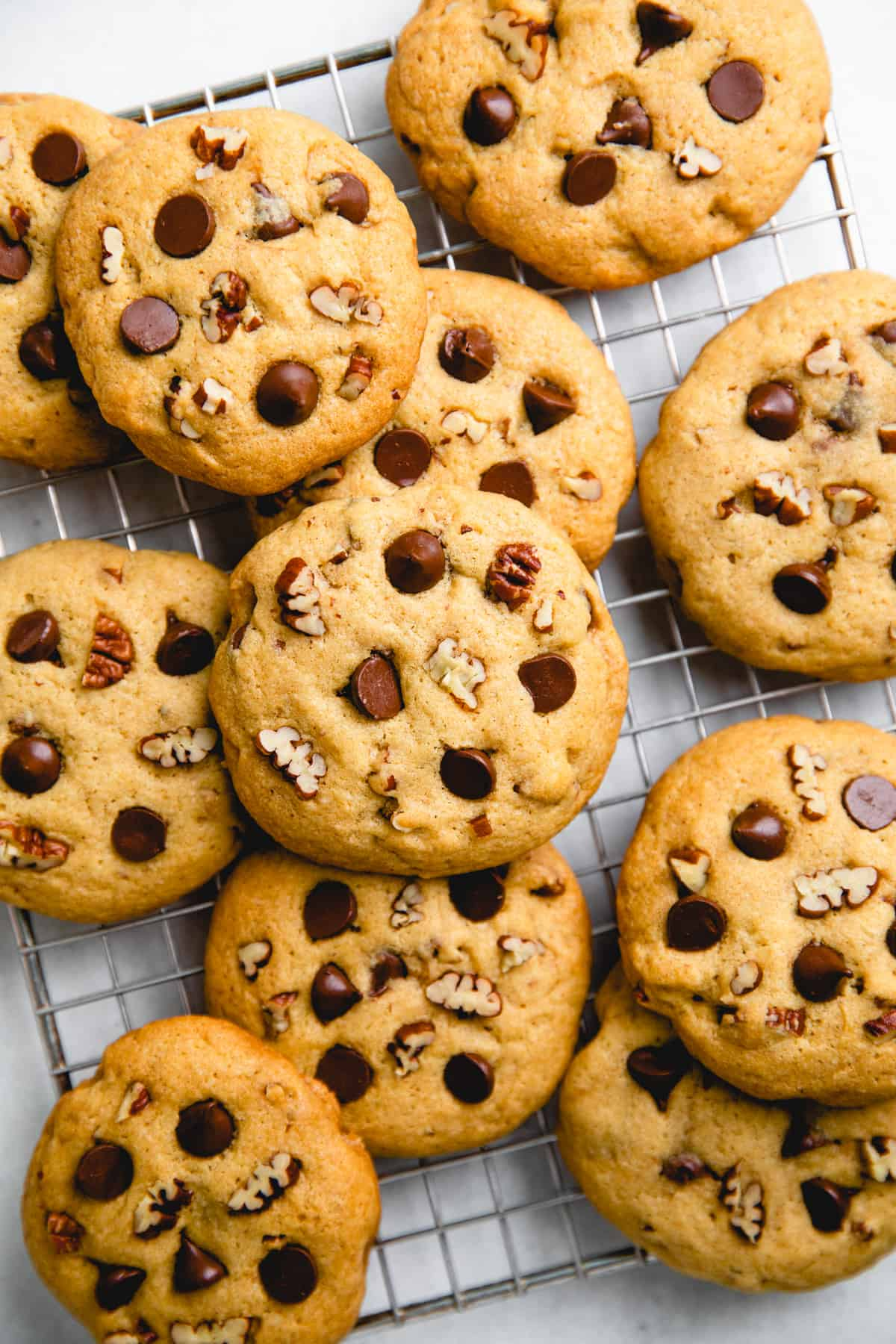 Pecan Chocolate Chip Cookies on a wire rack.